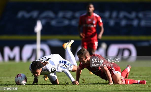 Helder Costa of Leeds United battles for possession with Joe Bryan of Fulham during the Premier League match between Leeds United and Fulham at...