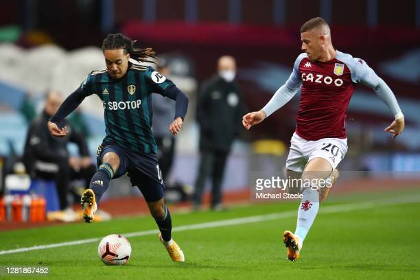 Helder Costa of Leeds United battles for possession with Ross Barkley of Aston Villa during the Premier League match between Aston Villa and Leeds...