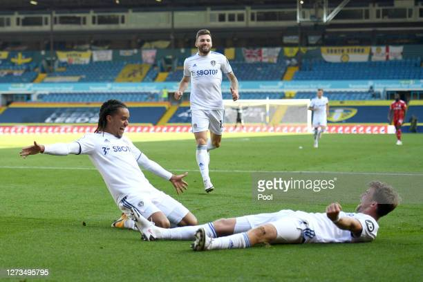 Helder Costa of Leeds United celebrates with teammate Patrick Bamford after scoring his team's fourth goal during the Premier League match between...