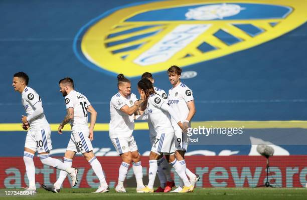 Helder Costa of Leeds United celebrates with teammates after scoring his team's first goal during the Premier League match between Leeds United and...