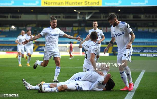 Helder Costa of Leeds United celebrates with teammates after scoring his team's fourth goal during the Premier League match between Leeds United and...