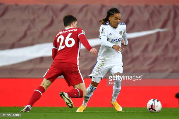 Helder Costa of Leeds United is challenged by Andy Robertson of Liverpool during the Premier League match between Liverpool and Leeds United at...