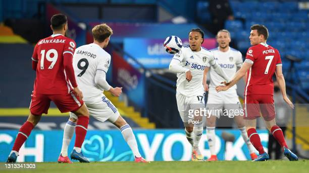 Helder Costa of Leeds United is challenged by James Milner of Liverpool during the Premier League match between Leeds United and Liverpool at Elland...
