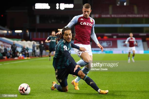 Helder Costa of Leeds United is fouled by Ross Barkley of Aston Villa during the Premier League match between Aston Villa and Leeds United at Villa...