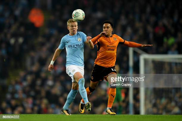 Helder Costa of Wolverhampton Wanderers and Alexander Zinchenko of Manchester City during the Carabao Cup Fourth Round match between Manchester City...