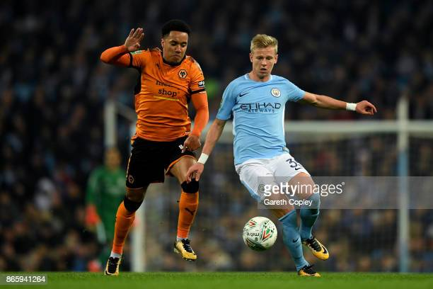 Helder Costa of Wolverhampton Wanderers and Alexander Zinchenko of Manchester City battle for the ball during the Carabao Cup Fourth Round match...