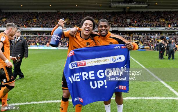 Helder Costa of Wolverhampton Wanderers and Ivan Cavaleiro of Wolverhampton Wanderers celebrate promotion to the Premier League during the Sky Bet...