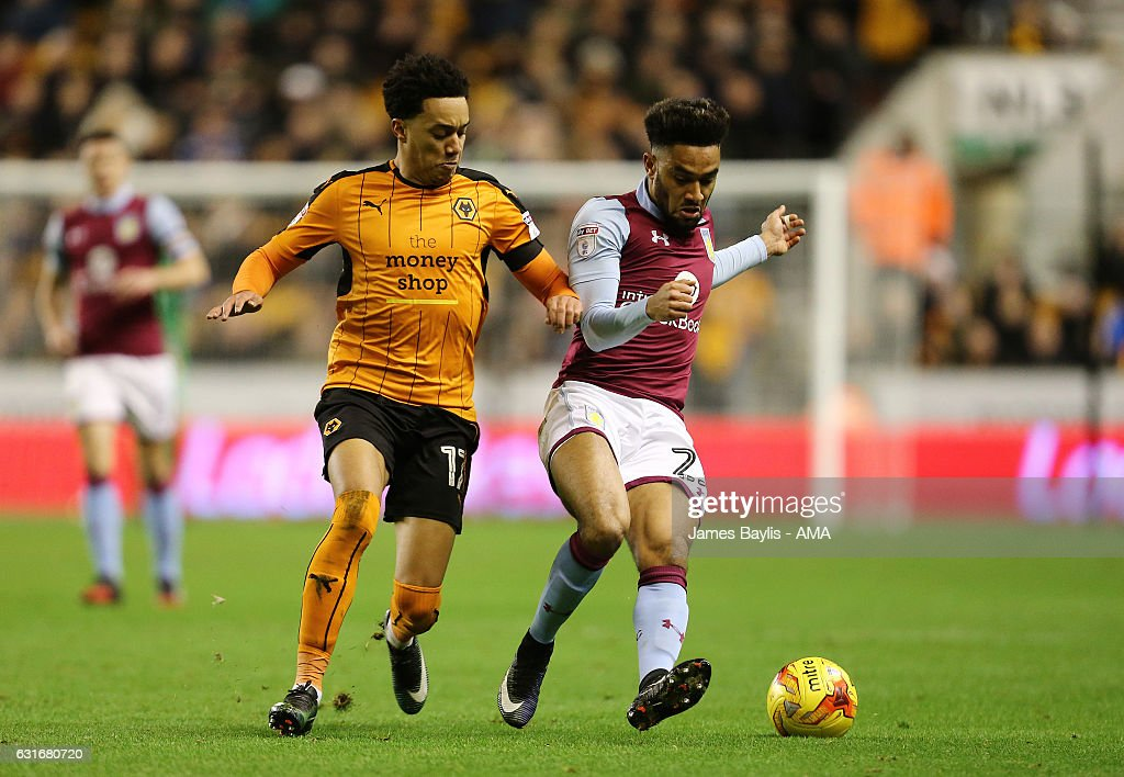 Helder Costa of Wolverhampton Wanderers and Jordan Amavi of Aston Villa during the Sky Bet Championship match between Wolverhampton Wanderers and Aston Villa at Molineux on January 14, 2017 in Wolverhampton, England.