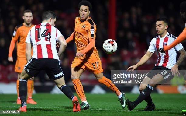 Helder Costa of Wolverhampton Wanderers and Nico Yennaris of Brentford during the Sky Bet Championship match between Brentford and Wolverhampton...