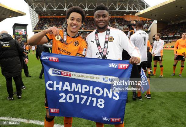 Helder Costa of Wolverhampton Wanderers and teammate Bright Enobakhare pose together after winning the Sky Bet Championship after the Sky Bet...