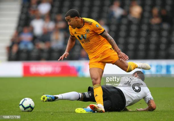 Helder Costa of Wolverhampton Wanderers beats Bradley Johnson of Derby County during a preseason friendly match between Derby County and...