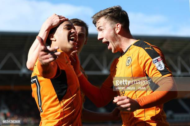 Helder Costa of Wolverhampton Wanderers celebrates after scoring a goal to make it 31 with Lee Evans the Sky Bet Championship match between...