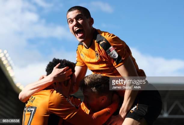 Helder Costa of Wolverhampton Wanderers celebrates with his team mates after scoring a goal to make it 31 as Conor Coady of Wolverhampton Wanderers...