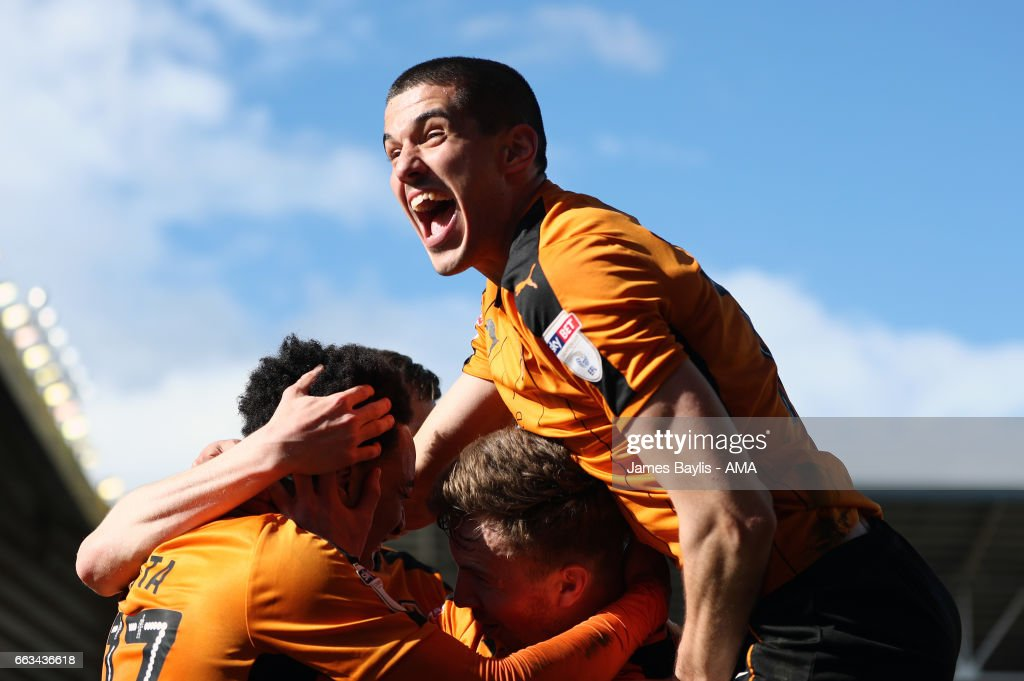 Helder Costa of Wolverhampton Wanderers celebrates with his team mates after scoring a goal to make it 3-1 as Conor Coady of Wolverhampton Wanderers jumps in to celebrate during the Sky Bet Championship match between Wolverhampton Wanderers and Cardiff City at Molineux on April 1, 2017 in Wolverhampton, England.