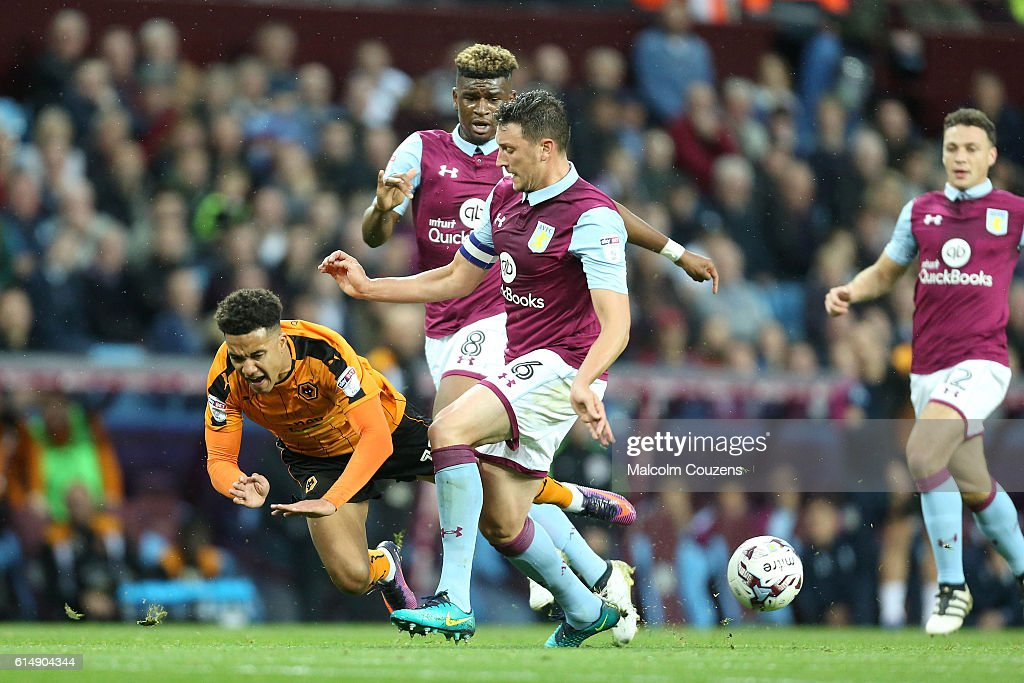 Helder Costa of Wolverhampton Wanderers is fouled by Tommy Elphick of Aston Villa during the Sky Bet Championship match between Aston Villa and Wolverhampton Wanderers on October 15, 2016 in Birmingham, England.