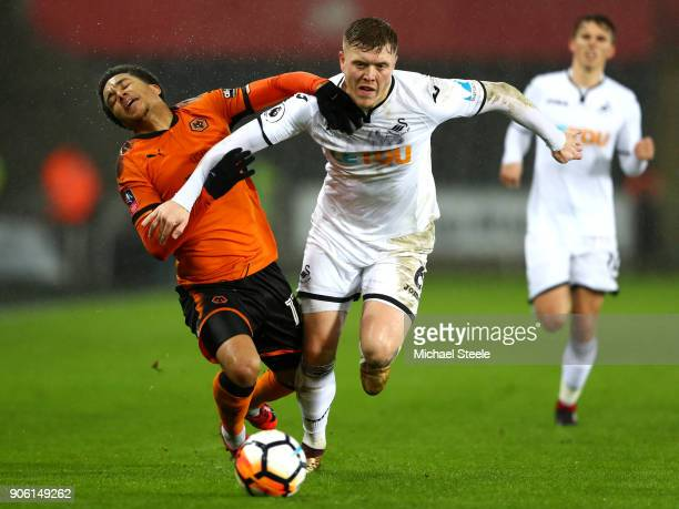 Helder Costa of Wolverhampton Wanderers is tackled by Alfie Mawson of Swansea City during The Emirates FA Cup Third Round Replay between Swansea City...