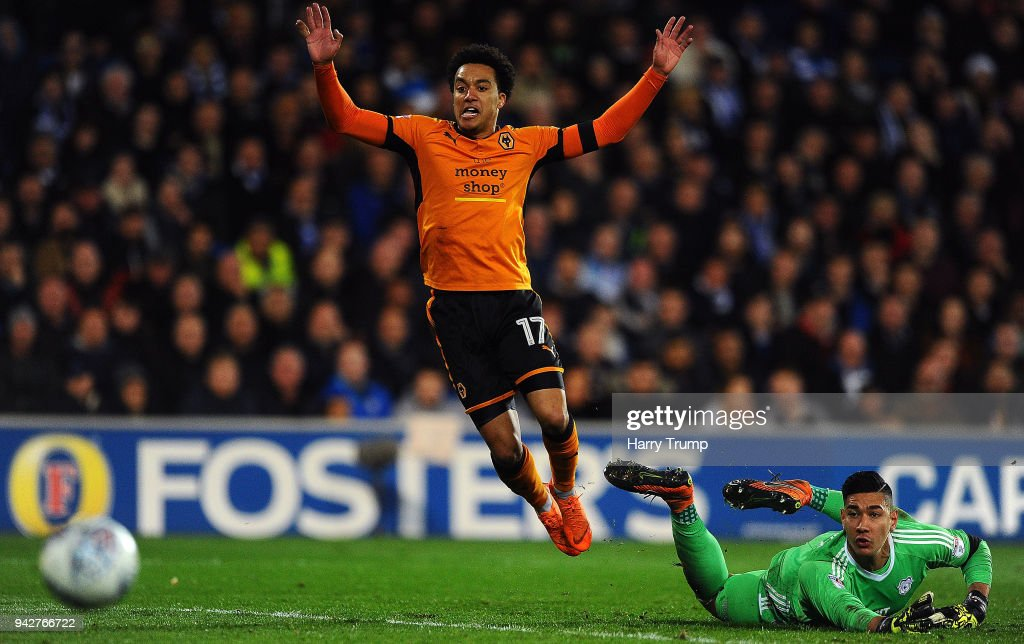 Helder Costa of Wolverhampton Wanderers(L) reacts after missing a chance as Neil Etheridge of Cardiff City(R) looks on during the Sky Bet Championship match between Cardiff City and Wolverhampton Wanderers at the Cardiff City Stadium on April 6, 2018 in Cardiff, Wales.