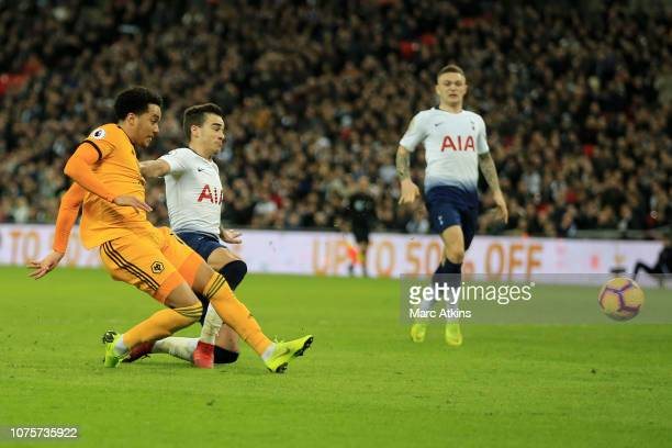 Helder Costa of Wolverhampton Wanderers scores his team's third goal past Harry Winks of Tottenham Hotspur during the Premier League match between...