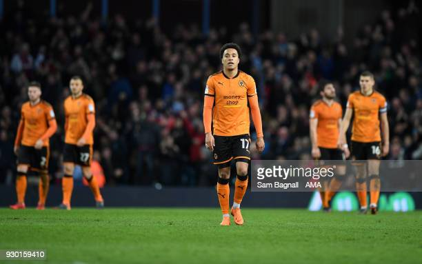 Helder Costa of Wolverhampton Wanderers stands dejected during the Sky Bet Championship match between Aston Villa and Wolverhampton Wanderers at...