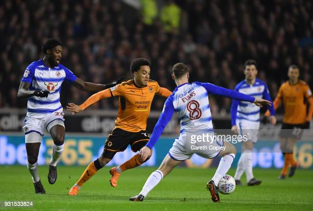 Helder Costa of Wolverhampton Wanders gets to the ball ahead of Tyler Blackett and George Evans of Reading during the Sky Bet Championship match...