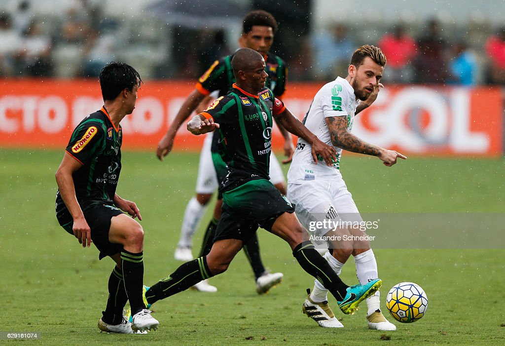 Helder (L) of America MG and Lucas Lima of Santos in action during the match between Santos and America MG for the Brazilian Series A 2016 at Vila Belmiro stadium on December 11, 2016 in Sao Paulo, Brazil.