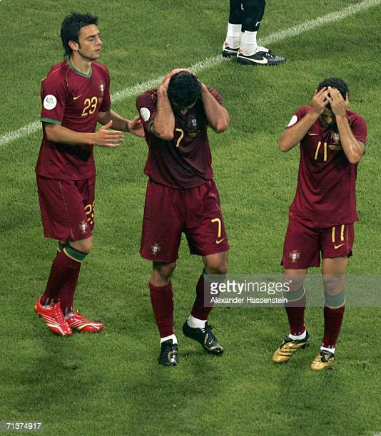 Helder Postiga, Luis Figo and Simao Sabrosa of Portugal react, after a missed chance on the French goal during the FIFA World Cup Germany 2006...