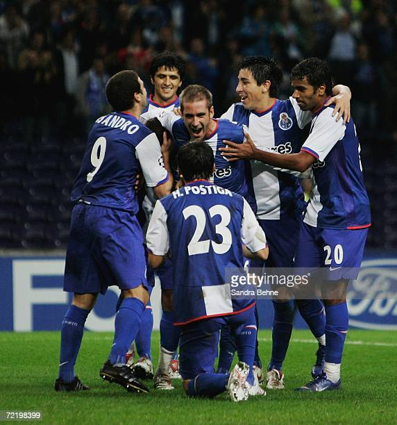 Helder Postiga of Porto celebrates with his team mates scoring the third goal during the UEFA Champions League group G match between FC Porto and...