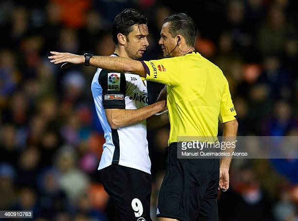 Helder Postiga of Valencia reacts to referee Muniz Fernandez during the La Liga match between Valencia CF and Levante UD at Estadio Mestalla on...