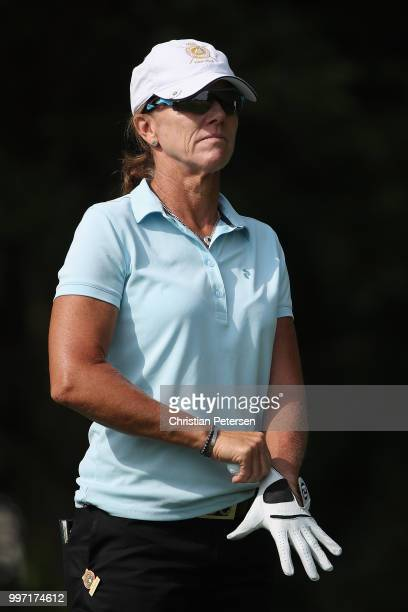 Helen Alfredsson of Sweden prepares to play a tee shot on the eighth hole during the first round of the US Senior Women's Open at Chicago Golf Club...
