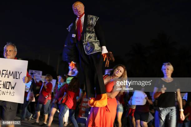 Helen Berggren holds an effigy of President Donald Trump as she joins with others during 'A Day Without A Woman' demonstration on March 8 2017 in...