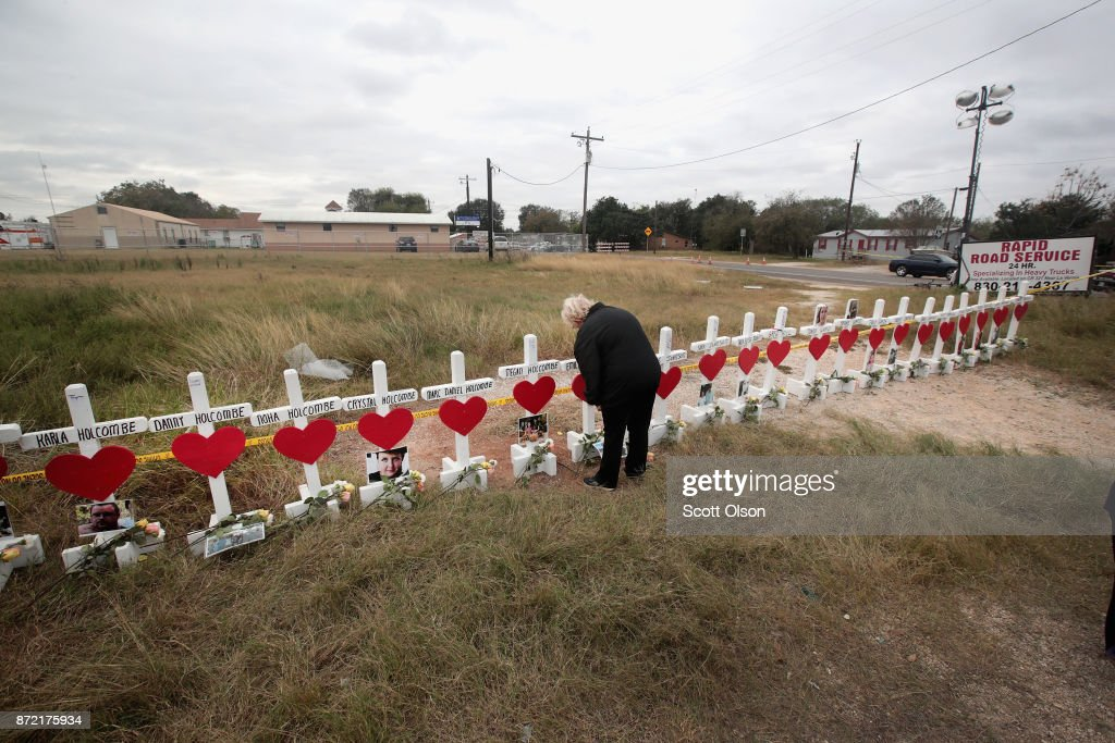 Helen Biesenbach leaves a message at a memorial where 26 crosses were placed to honor the 26 victims killed at the First Baptist Church of Sutherland Springs on November 9, 2017 in Sutherland Springs, Texas. On November 5, a gunman, Devin Patrick Kelley, shot and killed the 26 people and wounded 20 others when he opened fire during Sunday service at the church. Biesenbach, a member of the church, missed the November 5 service because she was babysitting her two-year-old grandson who was home with a fever. Biesenbach knew all the victims whose names are written on the crosses.