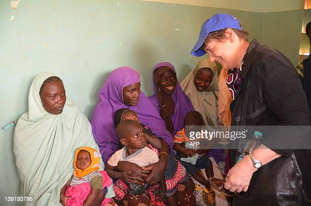 Helen Clark administrator of the United Nations Development Programme meets people in a malnutrish treatment center for children on February 17 2012...