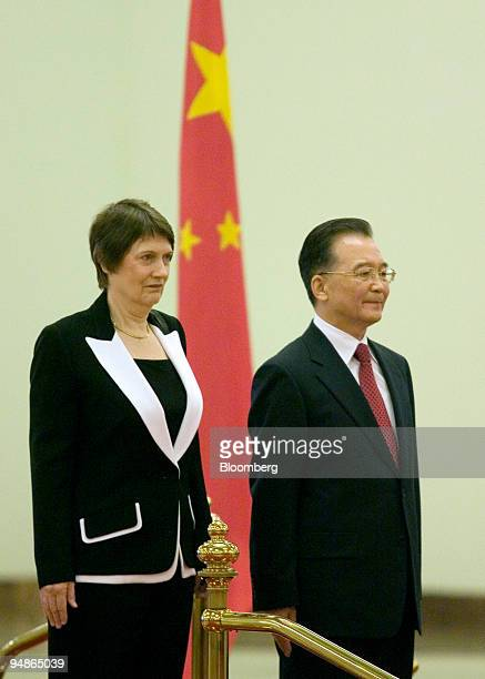 Helen Clark New Zealand's prime minister left stands with Wen Jiabao China's premier during a welcoming ceremony at the Great Hall of the People in...