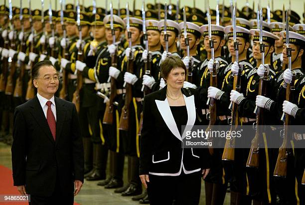 Helen Clark New Zealand's prime minister right and Wen Jiabao China's premier inspect an honor guard during a welcoming ceremony at the Great Hall of...