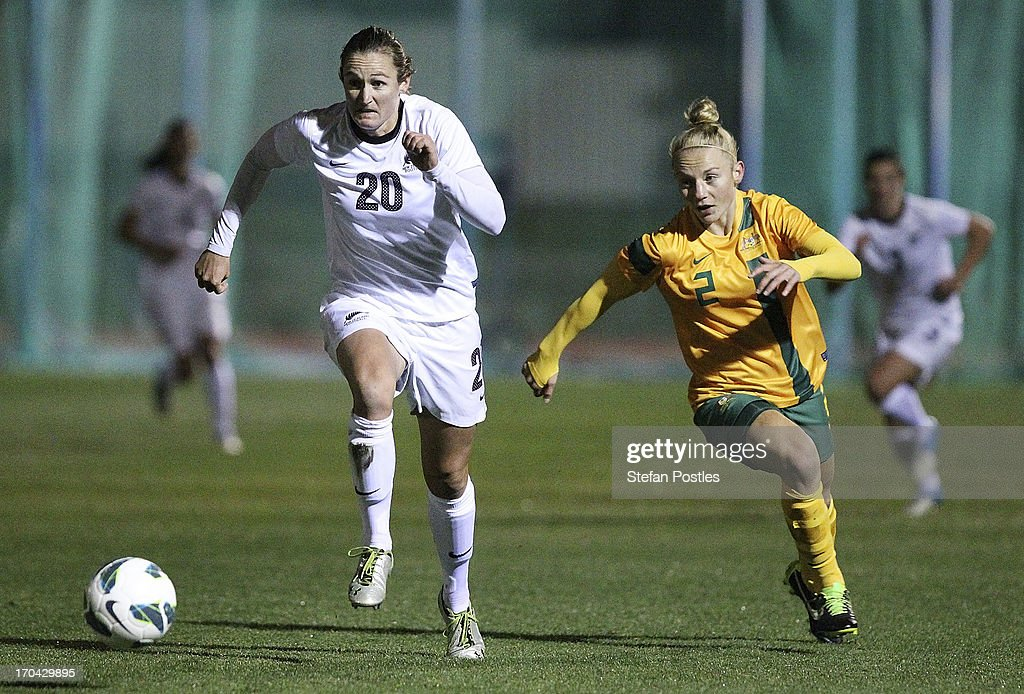 Helen Collins of New Zealand and Teigen Allen of Australia contest possession during game one of the Women's International Series between the Australian Matildas and the New Zealand Football Ferns at AIS on June 13, 2013 in Canberra, Australia.