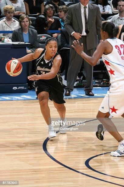 Helen Darling of the San Antonio Silver Stars drives against Stacey Lovelace of the Atlanta Dream during the WNBA game on June 18 2008 at Philips...