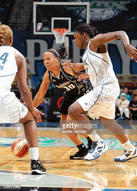 Helen Darling of the San Antonio Silver Stars moves the ball against Nicky Anosike and Charde Houston of the Minnesota Lynx during the game on July...