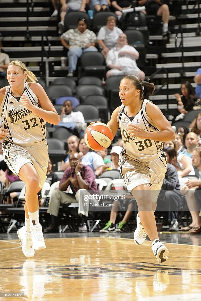Helen Darling #30 of the San Antonio Silver Stars moves the ball against the Phoenix Mercury during a WNBA game at the AT&T Center on August 3, 2010 in San Antonio, Texas.
