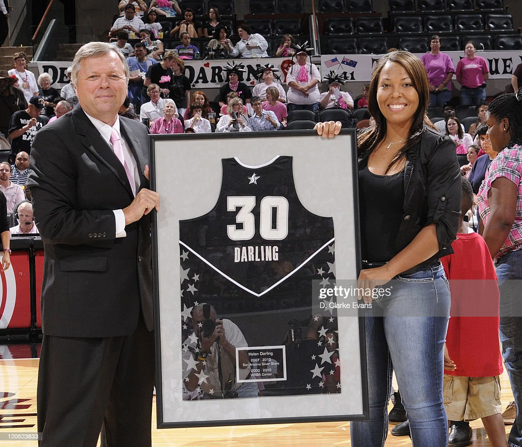 Helen Darling retired Silver Star player is honored as Dan Hughes, Head Coach of the San Antonio Silver Stars presents her with her retired jersey prior to the Silver Star game against the Tulsa Shock at the AT&T Center on August 6, 2011 in San Antonio, Texas.