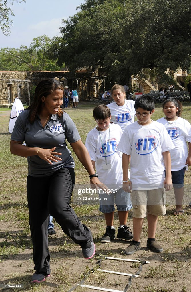 Helen Darling (L) shows boys and girls how to use the ladder to get in shape at the WNBA Clinic for Boys & Girls Clubs of San Antonio at Mission San Jose on July 20, 2011 in San Antonio, Texas.