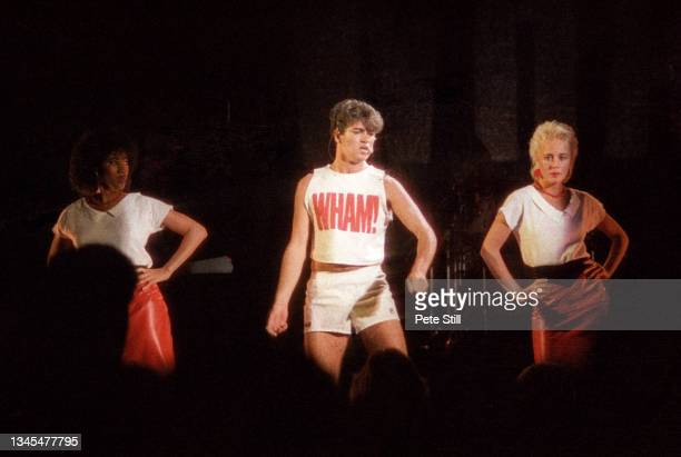 Helen DeMacque , George Michael of Wham and Shirlie Holliman perform on stage at Hammersmith Odeon on October 28th, 1983 in London, United Kingdom.