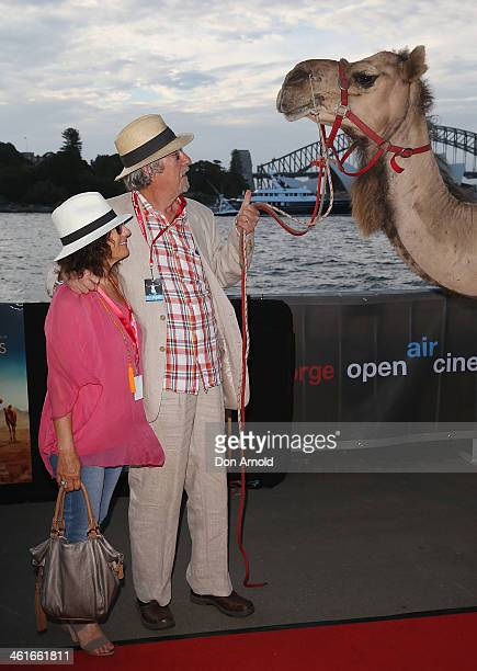 Helen Esakoff and Michael Caton pose alongside a camel at the St George Openair Cinema Tracks premiere on January 10 2014 in Sydney Australia