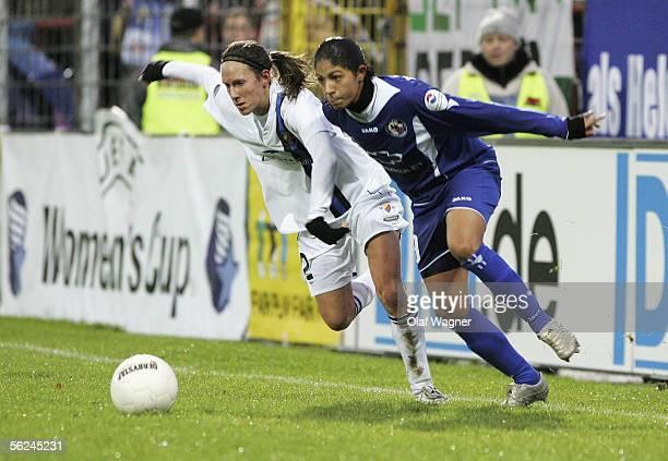 Helen Fagerstroem of Djurgarden and Cristiane of Potsdam battle for the ball during the UEFA Women's Cup Semi Final match between 1FC Turbine Potsdam...