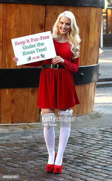 Helen Flanagan takes part in a photocall for PETA's 'Keep It FurFree Under the Xmas Tree' campaign at Covent Garden Piazza on December 11 2013 in...