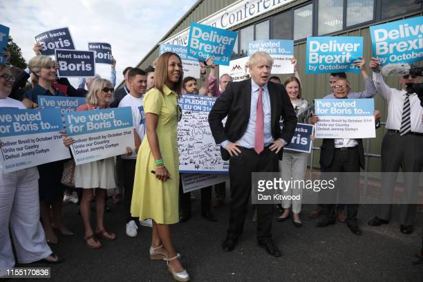 Helen Grant, MP for Maidstone and The Weald with Boris Johnson as they arrive for the Conservative leadership hustings at Kent Showground on July 11,...