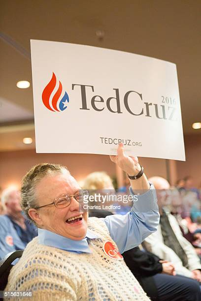Helen Hadix of Decatur Illinois reacts as US Senator Ted Cruz speaks at a campaign rally for the candidate on March 14 2016 in Decatur Illinois The...