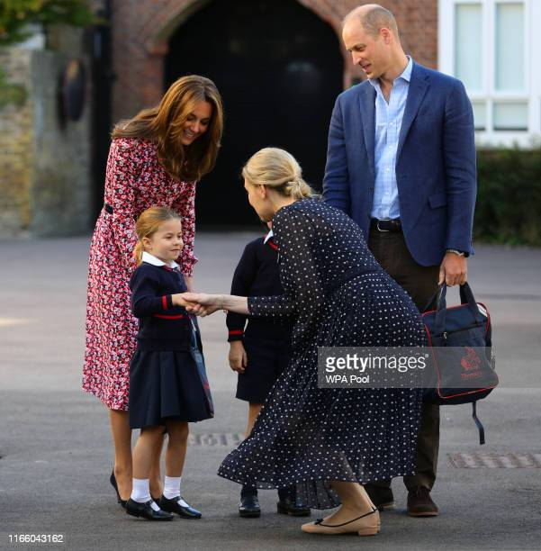 Helen Haslem, head of the lower school greets Princess Charlotte as she arrives for her first day of school, with her brother Prince George and her...