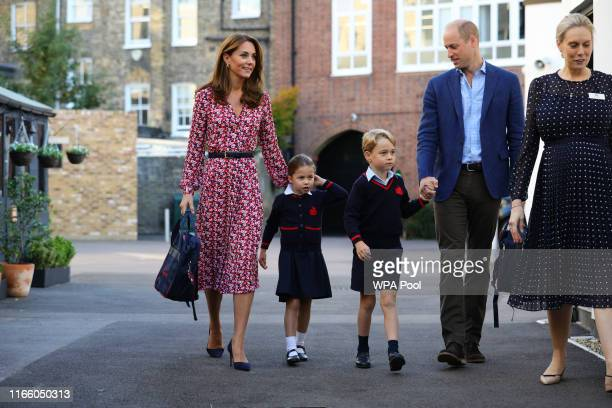 Helen Haslem head of the lower school greets Princess Charlotte as she arrives for her first day of school with her brother Prince George and her...