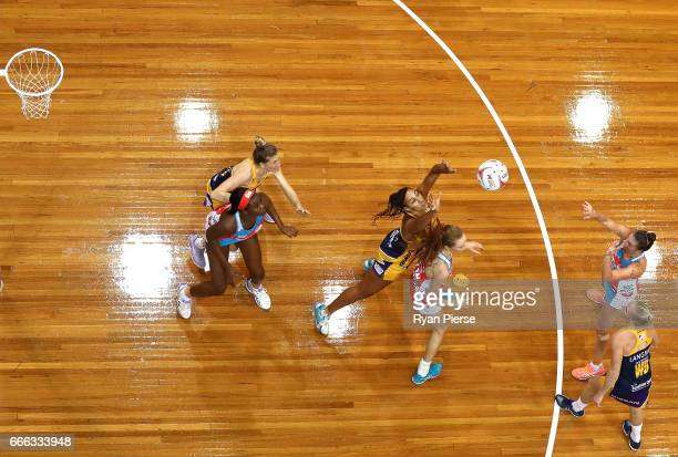 Helen Housby competes for the ball against Geva Mentor of the Lightning during the round eight Super Netball match between the NSW Swifts and the...