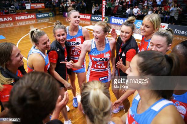Helen Housby of the Swifts celebrates with team mates after victory in the round 11 Super Netball match between the Swifts and the Fever at Sydney...